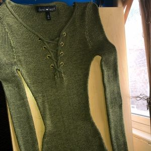 Long-sleeve, form-fitting green top